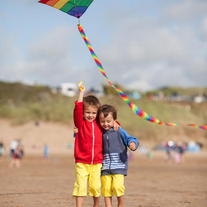 Kids flying a kite on Woolacombe Beach North Devon
