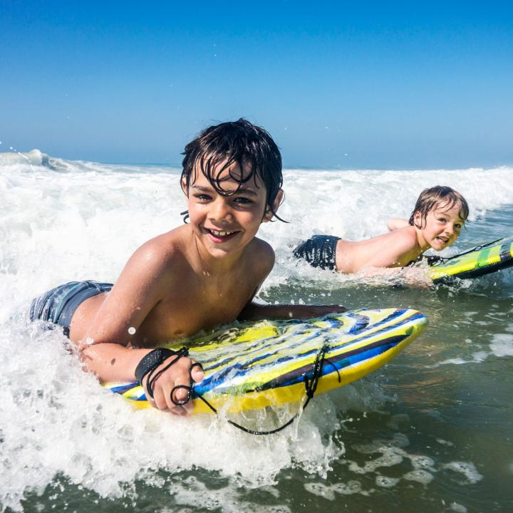 kids safely surfing on Woolacombe Beach North Devon